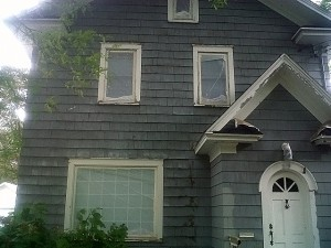 Before picture showing proper exterior residential paint preparation