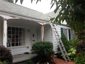 Full Color Painting picture of house siding refresh job during preparation for painting