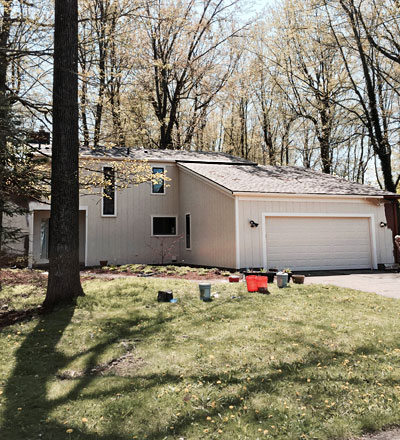 A house transformed with a residential painting job facelift from a recent home painting project in the Greater Lansing Michigan area.